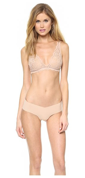 Commando soft cup bra in true nude - Swirls accentuate the delicate look of this stretch-lace...
