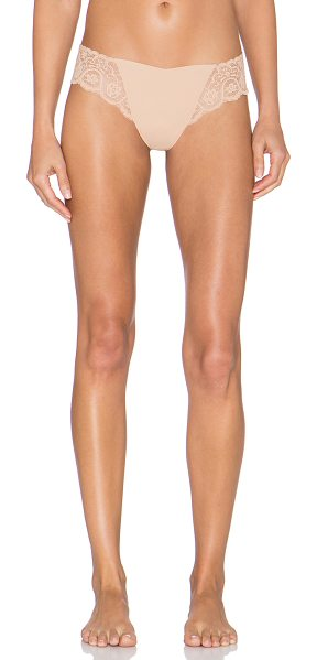 Commando Tulip hybrid thong in beige - 78% nylon 22% spandex. Hand wash cold. Stretch fit....