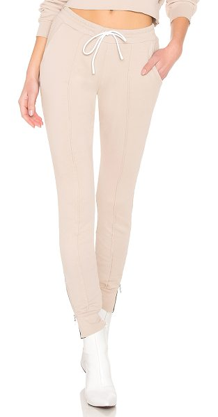 COTTON CITIZEN Milan Joggers With Ankle Zippers in nude - 100% cotton. Elasticized drawstring waist. Side slant...