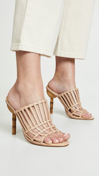 Cult Gaia ark heel slide sandals in sand - Leather: Cowhide Woven leather Padded footbed Slide...