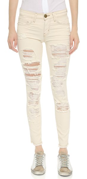 Current/Elliott The stiletto jeans with raw edges in au natural destroy - Dramatic shredded holes detail these bleached out...