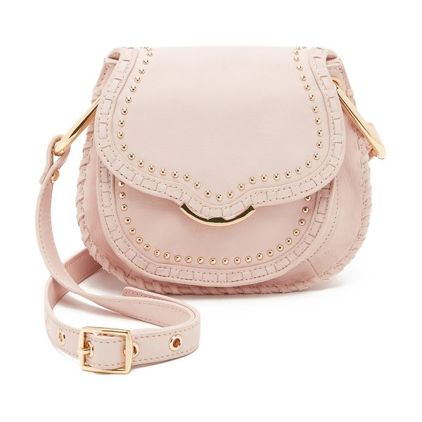 Cynthia Rowley Phoebe saddle bag in blush - Studs and whipstitching accentuate the classic...