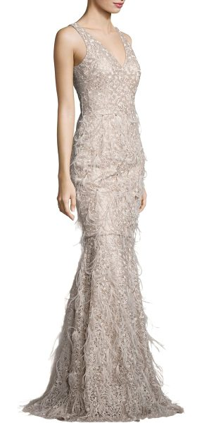 David Meister metallic embroidered lace & feather gown in champagne - Delicate feathers cascade down metallic lace gown.V-neck...