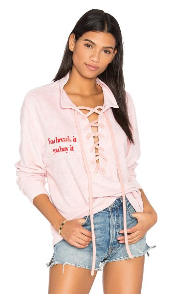 Daydream Nation Beach Dream Break It, You Buy It Pullover in pink - Cotton blend. Lace-up front with tie closure. Screen...