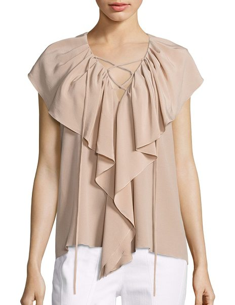 Derek Lam sleeveless ruffle blouse in sand - A ruffle front highlights this lace up silk blouse....