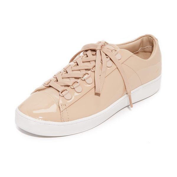 DKNY brayden d ring classic court sneakers in nude - Matte grommets trim the lace-up closure on these glossy...