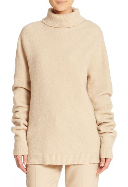 DKNY Turtleneck pullover sweater in buff - This cold-weather classic is updated with a roomy,...