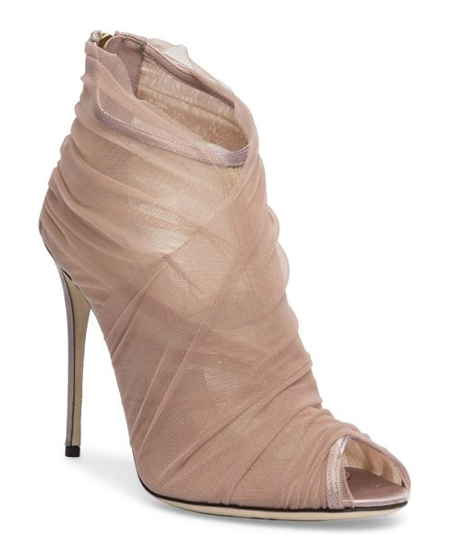 Dolce & Gabbana tulle peep toe booties in nude - Sheer tulle elegantly wraps around peep-toe bootie....