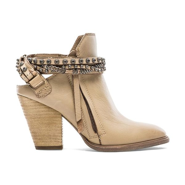 Dolce Vita Hollice bootie in taupe - Leather upper with man made sole. Heel measures approx...