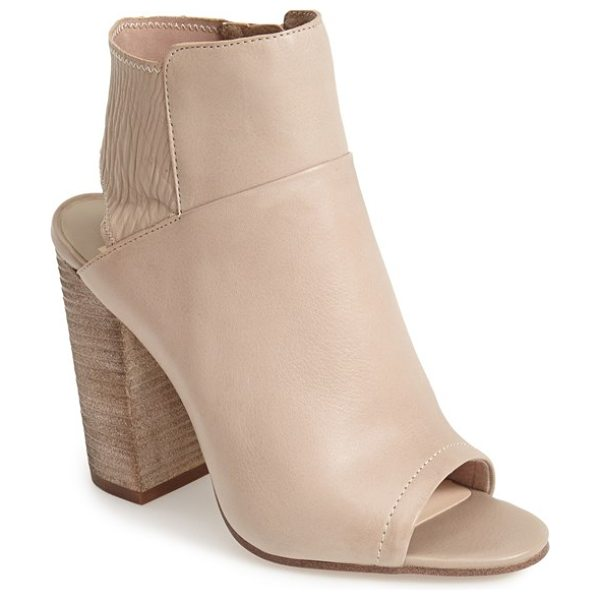 Dolce Vita leka open toe bootie in taupe - A bold heel cutout and peep toe intensify the clean,...