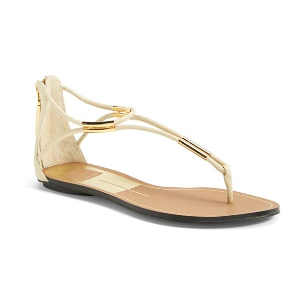Dolce Vita marnie flat sandal in vanilla - Metallic hardware gleams at the toe and ankle of an...