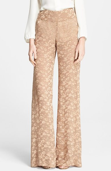 Donna Karan floral fil coupe pants in nude - A defined high waist and flowy wide-cut legs shape the...