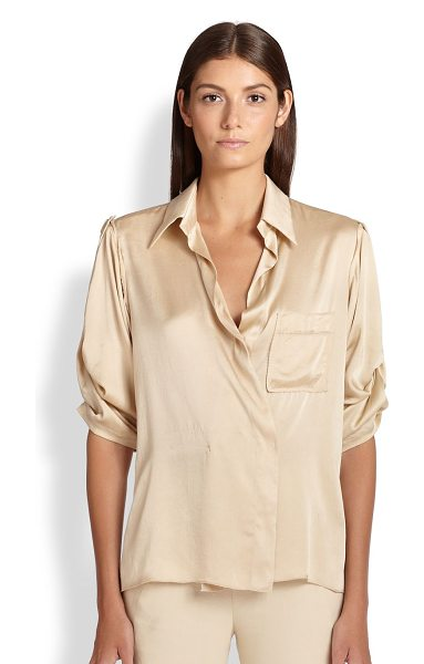 Donna Karan Stretch silk surplice blouse in parchment - The classic button-down is transformed in luminous...