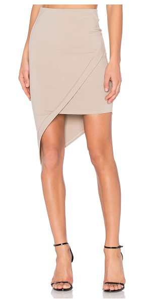 """Donna Mizani Asymmetrical Skirt in beige - """"60% rayon 40% nylon. Dry clean only. Unlined...."""