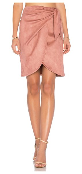 """Donna Mizani Leona Skirt in rose - """"90% nylon 10% spandex. Dry clean only. Unlined. Wrap..."""