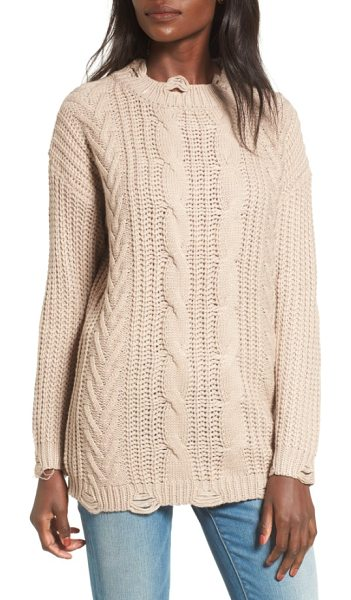 DREAMERS BY DEBUT distressed cable knit sweater in mocha - Distressed patches line the neck, cuffs and hem of a...
