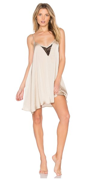 EASTNWEST Slip Dress in beige - 100% poly satin. Hand wash. Unlined. Guipure lace trim....