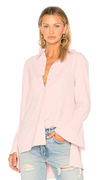 EDIT Shirt With Applique Back - 100% poly. Dry clean only. Hidden front button placket....