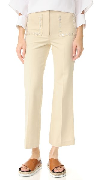 EDUN flare pants in ecru - High-waisted EDUN pants in a wide-leg profile. Buttons...