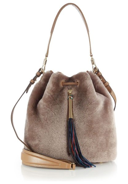 Elizabeth and James Cynnie shearling bucket bag in stone - Crafted of plush shearling and trimmed with leather,...