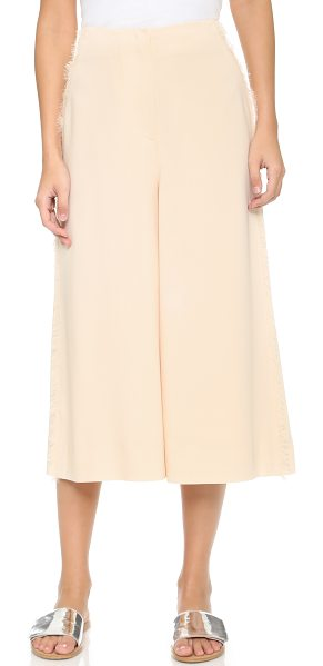 Elizabeth and James Frayed presli trousers in vanilla - Frayed fringe trims the hip pockets and side seams on...
