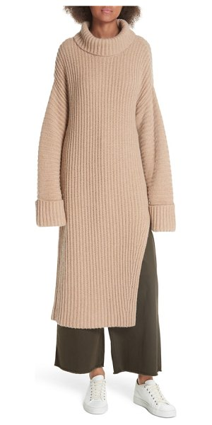 Elizabeth and James mae wool & cashmere sweater in beige - A slit at one side creates clean lines and modern...