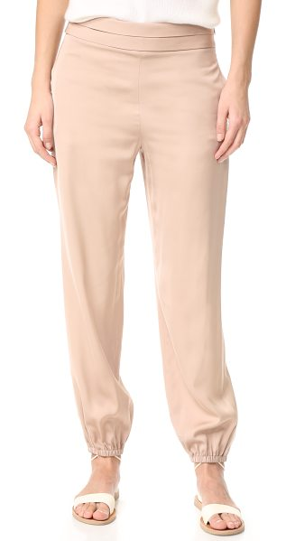ELIZABETH AND JAMES pascal tapered bottom pants - A polished finish lends a silky feel to these slinky...