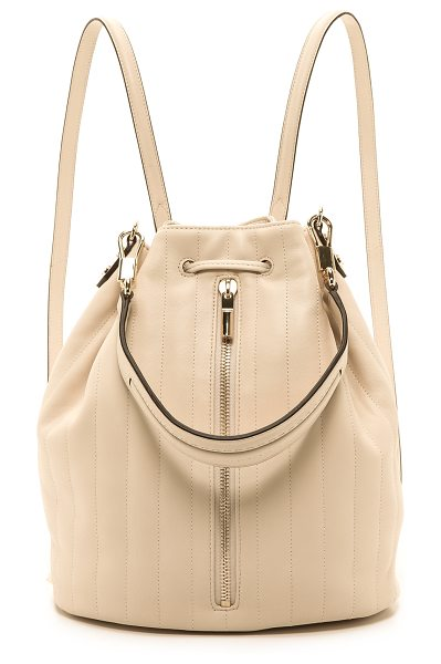 Elizabeth and James Quilted cynnie sling backpack in cream - Soft quilted leather composes a signature Elizabeth and...