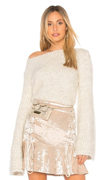 Endless Rose Cropped Sweater in cream - 64% poly 24% nylon 12% acrylic. Hand wash cold. Fringe...