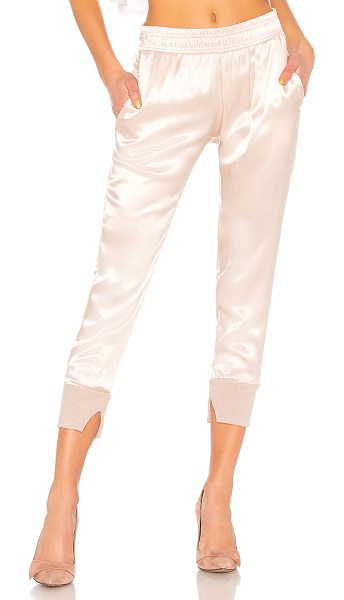 Enza Costa Cuffed Jogger Pant in pink - Self: 100% rayonTrim: 85% cotton 15% cashmere. Hand wash...