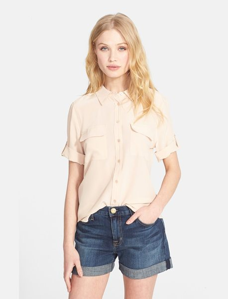Equipment slim signature short sleeve silk shirt in nude - A crisp collar, roll-tab sleeves and dual chest pockets...
