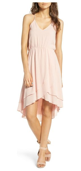 everly ruffle hem dress in blush - A surplice skirt with a softly ruffled high/low hem adds...