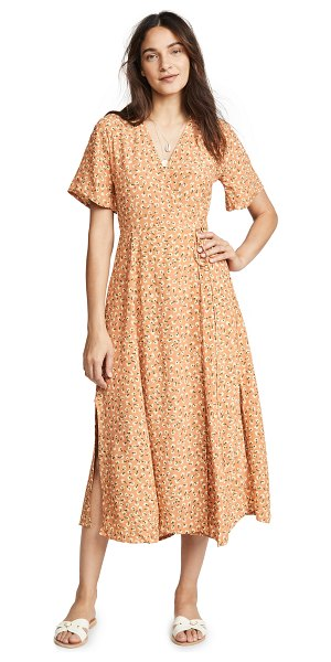 Faithfull The Brand leila wrap dress in vintage blossom - Fabric: Lightweight weave Flowy sleeves Side slit Floral...