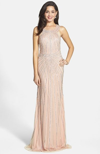 Faviana embellished tulle column gown in blush - A clean, linear pattern of glittering sequins and...