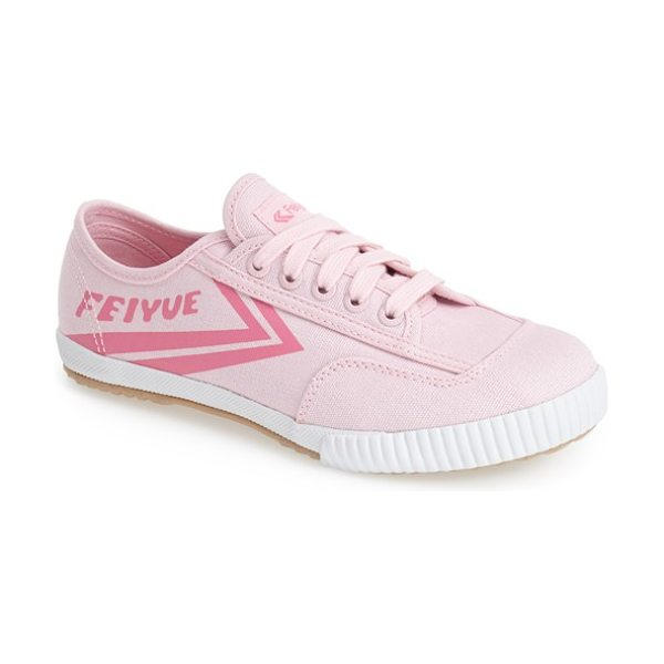 Feiyue. fe lo plain canvas sneaker in pink - Signature arrow stripes further the athletic, retro...