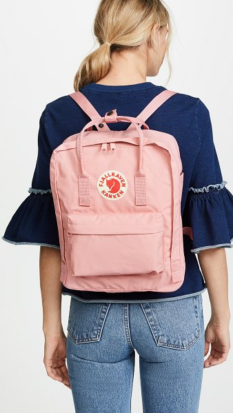 Fjallraven kanken backpack in pink - Fabric: Canvas Logo patch Zip at top Patch interior...
