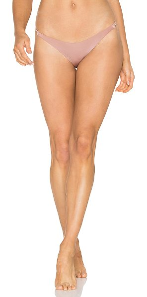 Fleur du Mal No Show String Cheeky in mauve - Nylon blend. Hand wash cold. Elastic stretch fit. Lace...