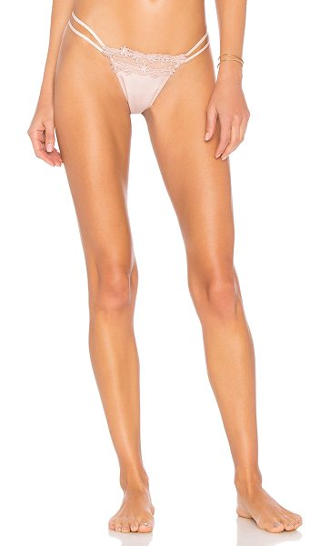 Flora Nikrooz Showstopper Thong in pink - Self: 100% polyContrast: 100% nylon. Hand wash cold....