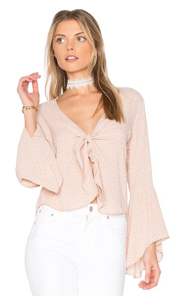 Flynn Skye Knot Your Business Top in beige - Poly blend. Hand wash cold. Tie front closure. Flared...