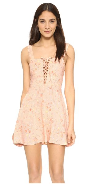 FLYNN SKYE Leila lace up mini dress - A soft floral print complements the feminine feel of...