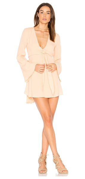 Flynn Skye London Mini Dress in peach - Poly blend. Hand wash cold. Unlined. Draped bodice...