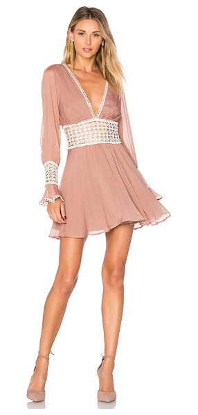 For Love & Lemons Celine Mini Dress in blush - Self: 53% silk 47% viscoseLining: 97% poly 3% spandex....