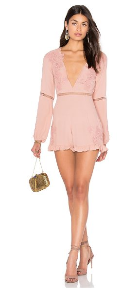 For Love & Lemons Lilou Floral Romper in dusty pink - Self: 55% viscose 45% rayonContrast: 100% cotton. Dry...