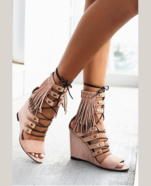FP Collection None in blush - Luxe leather open toe wedges featuring statement fringe...
