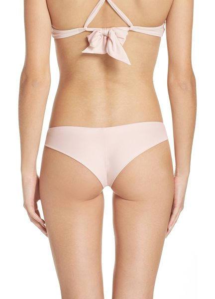 Frankie's Bikinis marina bikini bottoms in blush - Simple but sultry, these cheeky bottoms give you a...