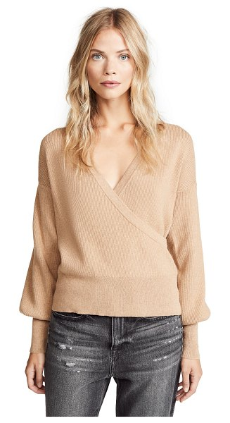 Fred and Sibel crossover sweater in sand - Fabric: Ribbed knit Balloon sleeves Wrap silhouette...