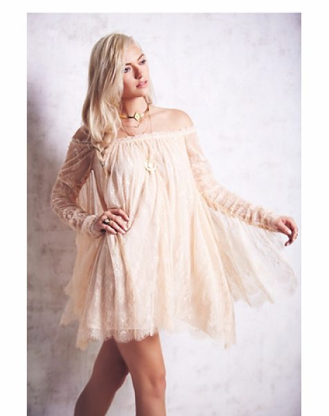 Free People Angel lace trapeze mini dress in champagne - Femme lace babydoll. Dramatic lace panels cascade from...