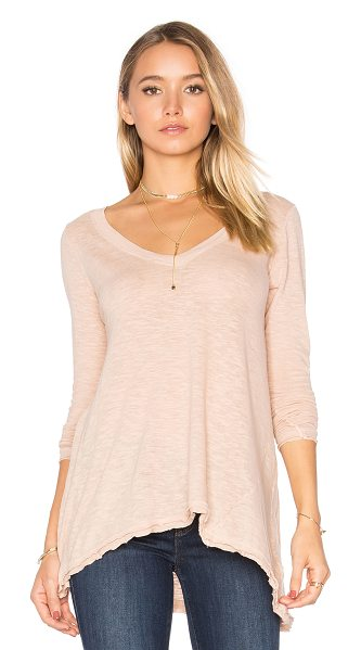 Free People Anna Tee in blush - 100% cotton. Slub knit fabric. Raw cut asymmetrical hem....