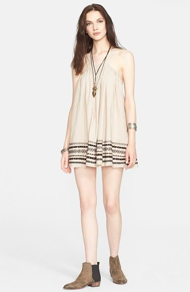 Free People batiste embroidered cotton dress in biscotti - Kashmir-style embroidery adds an artisanal aesthetic to...
