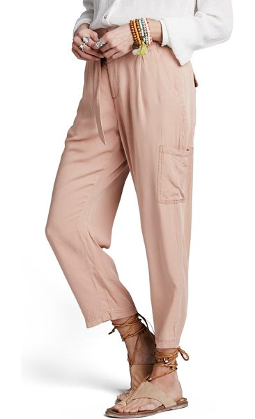 Free People crop cargo pants in peach - A wide waistband with gently shirred details tops soft,...